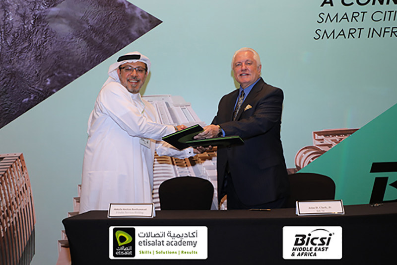 Shown completing the signing of the Etisalat Academy – BICSI ADTP agreement is Abdulla Hashim Banihammad, CEO, Etisalat Services Holding, and John D. Clark, Jr. Executive Director and CEO, BICSI.""